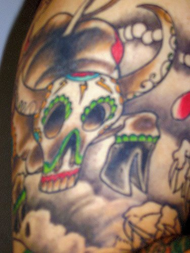 Dia de muertos style bull skull tattoo